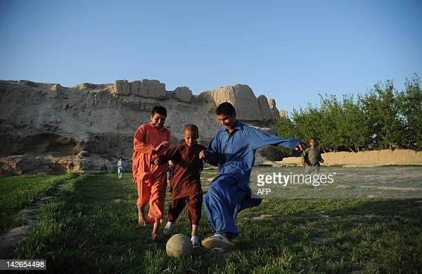 Afghan boys play football on the outskirts of Mazari Sharif capital of Balkh province on April 10 2012 Mazari Sharif the capital of Balkh province is...