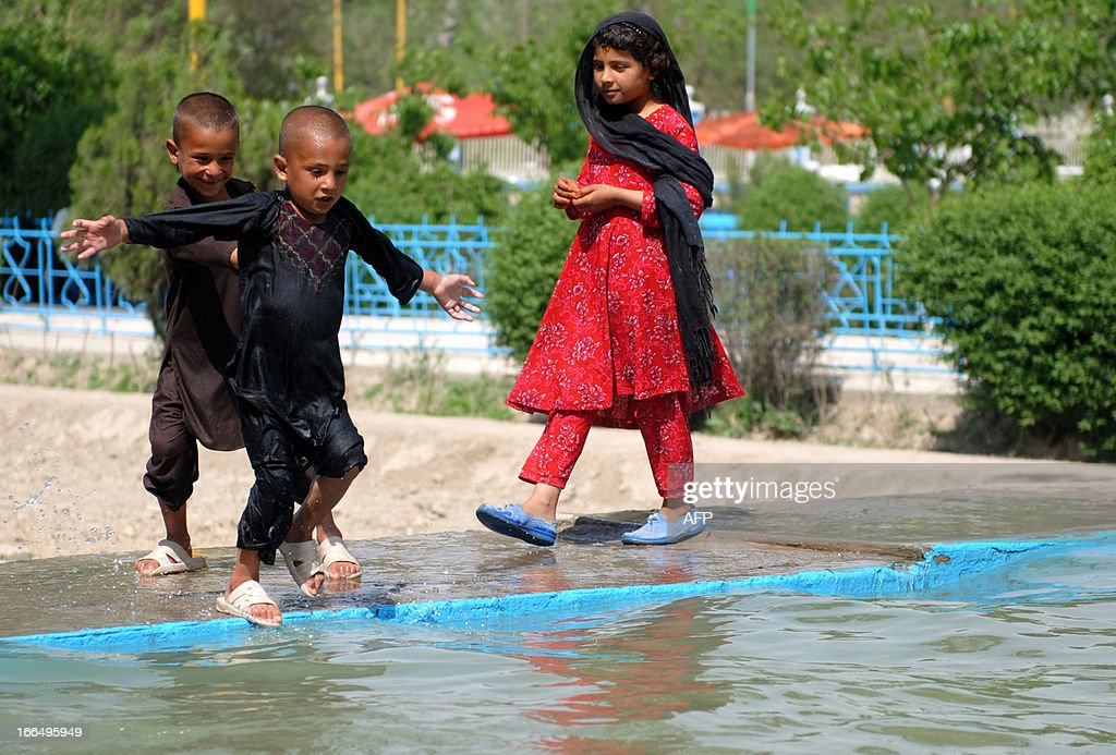 Afghan boys play in a pool at Hazrate Ali shrine in MazariSharif capital of Balkh province on April 13 2013 Trying to recover from 30 years of...
