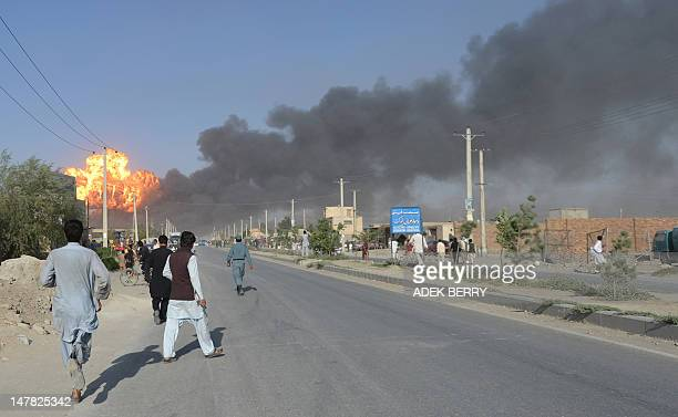 Afghan bystanders react following an explosion at a fuel warehouse in Kabul on July 4 2012 A huge explosion at a gas and fuel warehouse along the...