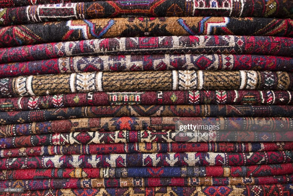Afghan carpets are piled in a shop in the northwestern city of Herat on April 2, 2014. Carpets are Afghanistan's best-known export, woven mostly by women and children in the north of the country, a trade which once employed, directly or indirectly, six million people, or a fifth of the country's population, but that figure has dropped sharply.