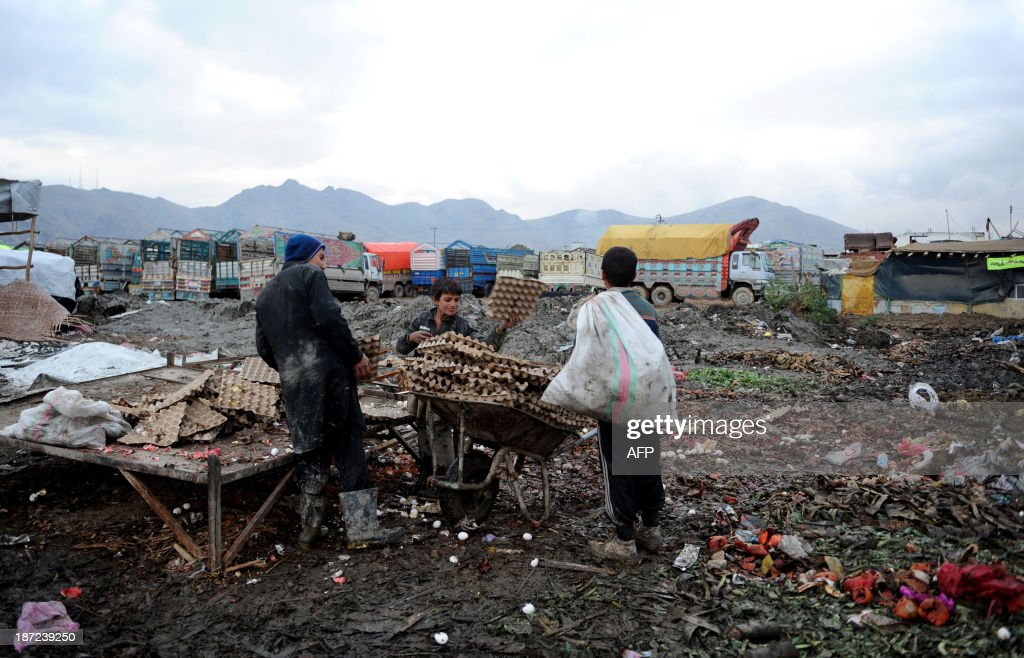 Afghan child labourers collect cardboard and other materials from a rubbish dump to be used as firewood as winter begins in Kabul on November 7, 2013. Tens of thousands of children in Afghanistan, driven by poverty, work on the streets of the war-torn country's cities and often fall prey to Taliban bombings and other violence, as well as abuse.