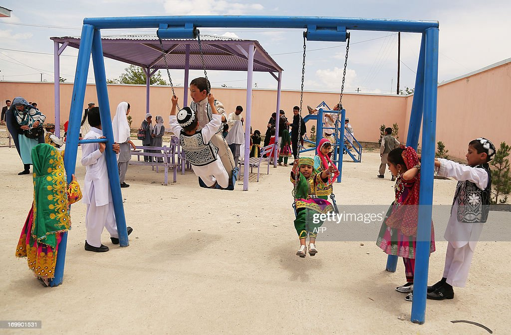 Afghan children play at a government kindergarten in Ghazni on June 4, 2013. Tens of thousands of children in Afghanistan, driven by poverty, work on the streets of the war-torn country's cities and often fall prey to Taliban bombings and other violence, as well as abuse. AFP PHOTO/ Rahmatullah ALIZADA