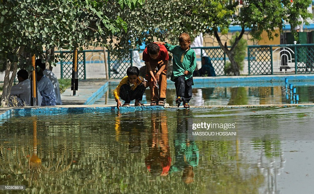 Afghan children play at the Rawze Sharif shrine in northern Mazare Sharif city in Balkh province on July 16 2010 Also known as the Blue Mosque it is...