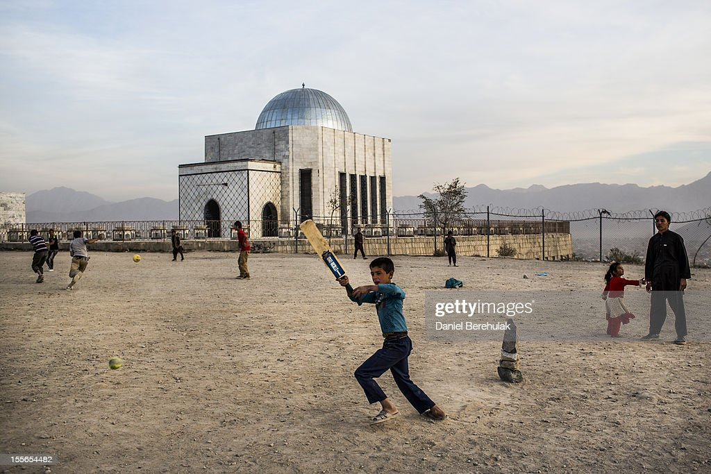 Afghan children play cricket as other play soccer at Teppe Maranjanin in front of the Tomb of King Mohammad Nadir Shah on November 6, 2012 in Kabul, Afghanistan. The tomb was built in commemoration of King Mohammad Nadir Shah who was assassinated in 1933.