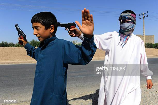Afghan children play with plastic toy guns during the second day of Eid alFitr in Herat on August 9 2013 Muslims around the world are celebrating Eid...