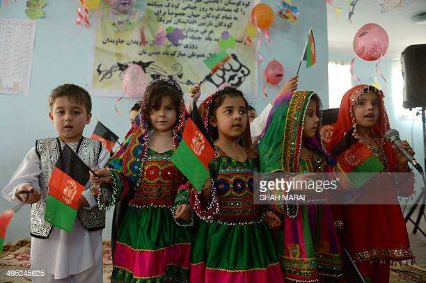 Afghan children sing as they celebrate Children's Day at Maher Mother Kindergarten in Kabul on June 2 2014 Children's Day is celebrated...