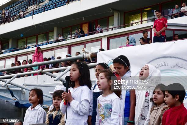 Afghan children sing during the celebrations of Nauroz 'New day' the traditional Afghan New Year's Day on March 21 2017 at the Hockey refugee camp...