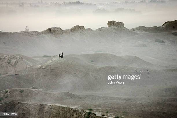 Afghan children sit atop the ramparts of the ancient Bala Hizar fortress of Balkh on October 12 in Afghanistan The French Archaeological Delegation...