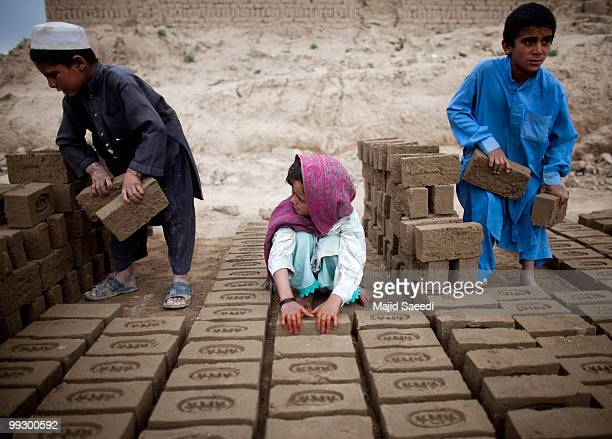 Afghan children sorts bricks at the Sadat Ltd Brick factory where they work from 8am to 5 pm daily on May 14 2010 in Kabul Afghanistan Child labour...