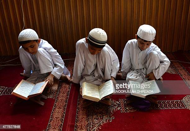 Afghan children study the Quran during first day of the month of Ramadan at a mosque in Jalalabad on June 18 Islam's holy month of Ramadan which is...