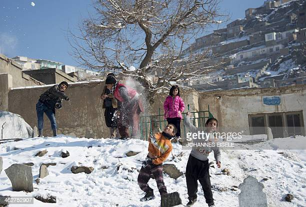 Afghan children take part in a snowball fight on a hill overlooking Kabul on January 9 2014 As winter sets in across Central Asia many Afghans...
