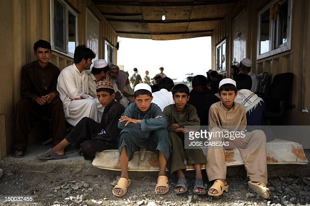 Afghan children wait as their parents meet with US military personnel at the Combat Outpost Lakon in Buwri Tana District Khost Province on August 9...