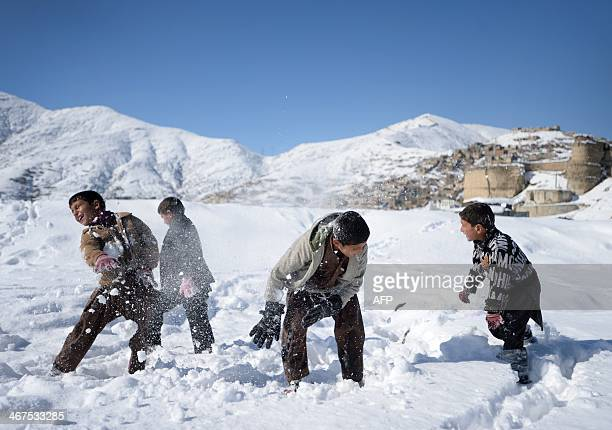 Afghan childrens play in the snow at Shuhada Lake in Kabul on February 7 2014 As winter sets in across Central Asia many Afghans struggle to provide...