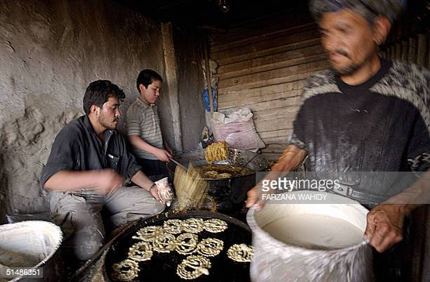 Afghan confectioners prepare Jalebi a local sweet prior to the breaking of the fast during Ramadan in Kabul 16 October 2004 During the Islamic holy...