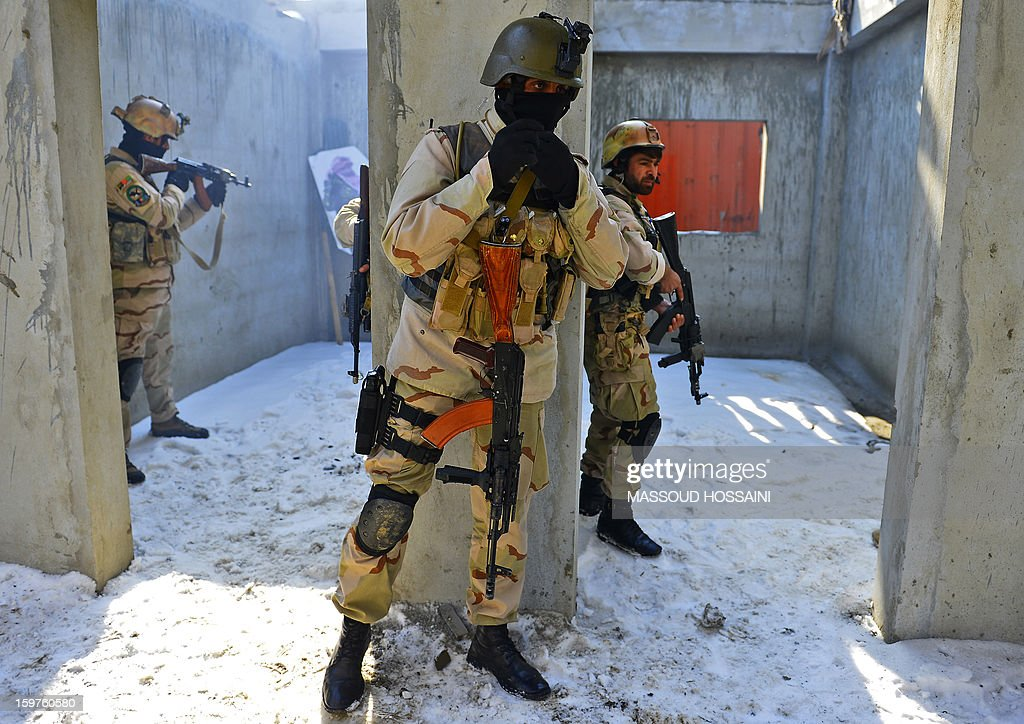 Afghan Crisis Response Unit (CRU) forces perform a house entry drill during an exercise at their camp on the outskirts of Kabul on January 20, 2013. The Afghan Crisis Response Unit (CRU) are trained by US and British forces with the task of counter-terrorism and drug enforcement duties in the country.