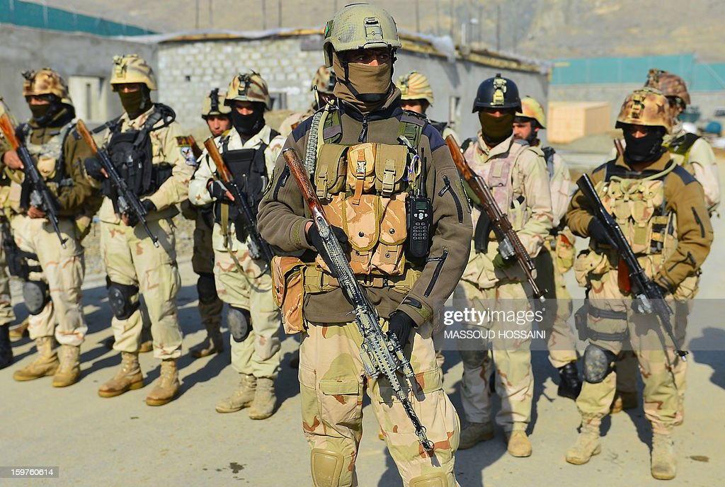 Afghan Crisis Response Unit (CRU) forces stand in formation during an exercise at their camp on the outskirts of Kabul on January 20, 2013. The Afghan Crisis Response Unit (CRU) are trained by US and British forces with the task of counter-terrorism and drug enforcement duties in the country. AFP PHOTO/MASSOUD HOSSAINI
