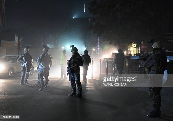 Afghan Crisis Response Unit personnel stand guard at the site of bomb attack on the Spanish embassy compound in Kabul on December 11 2015 Insurgents...