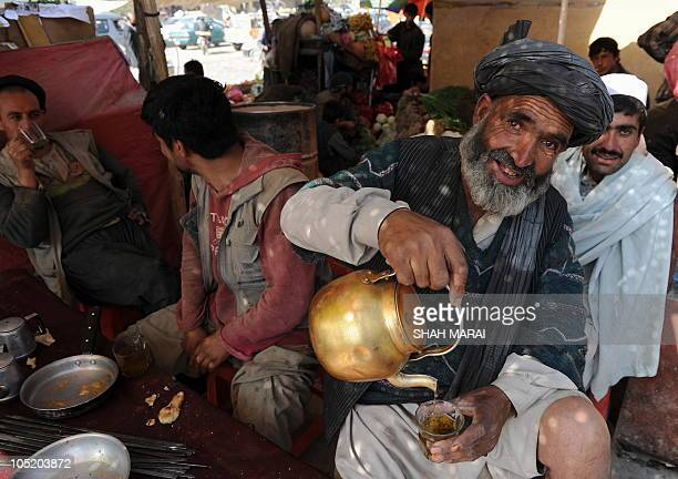 Afghan day laborers have their breakfast at the vegetable market in Kabul on October 12 2010 Afghanistan is one of the world's poorest countries...