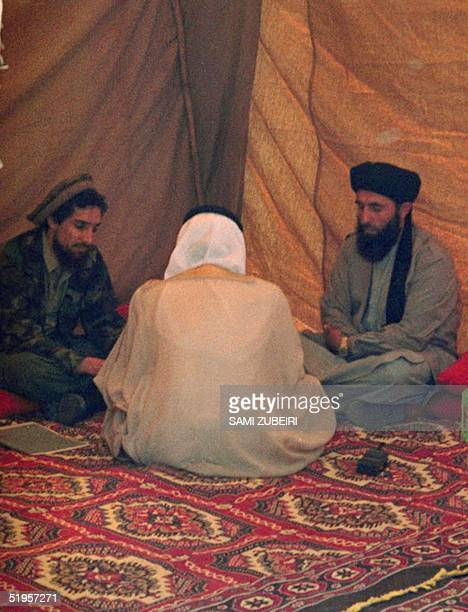 Afghan Defence Minister Ahmad Shah Masood Saudi mediator Abdullah Naif and fundamentalist guerrilla leader Gulbuddin Hekmatyar confer during peace...