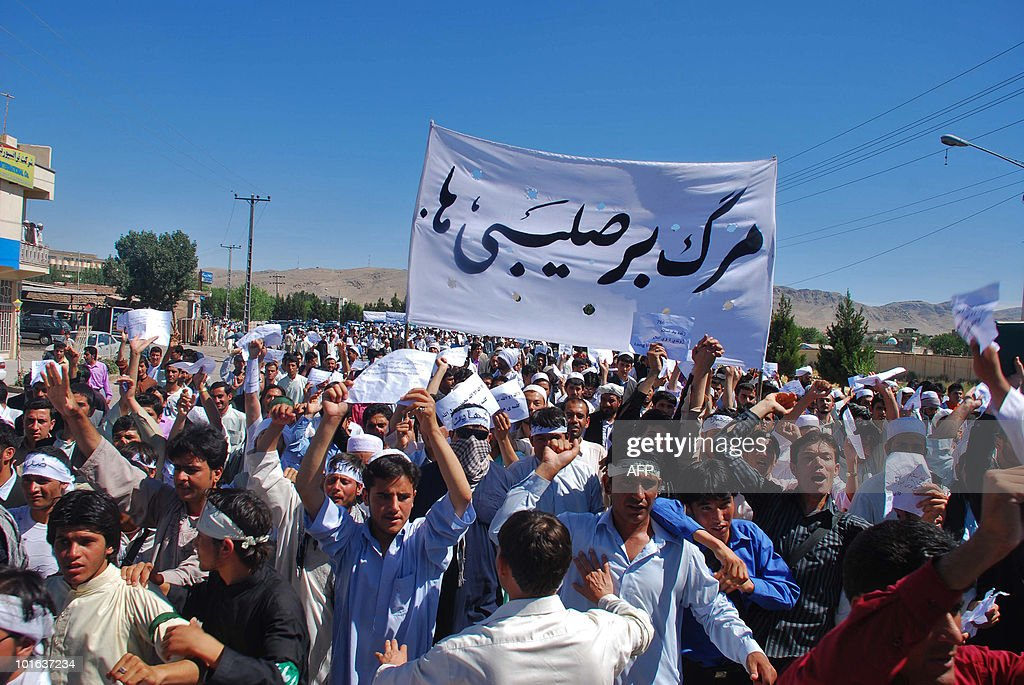 Afghan demonstrators shout slogans during a demonstration against two Christian organisations in Herat city, west of Kabul on June 5, 2010. The Afghan government has suspended two Christian aid groups after a TV show reported they were proselytising, which is illegal in the devoutly Islamic country. The organisations -- Norwegian Church Aid and Church World Service of the United States -- were being investigated after Noorin TV reported they had converted Afghan Muslims to Christianity, the economics ministry said. AFP PHOTO/Aref KARIMI