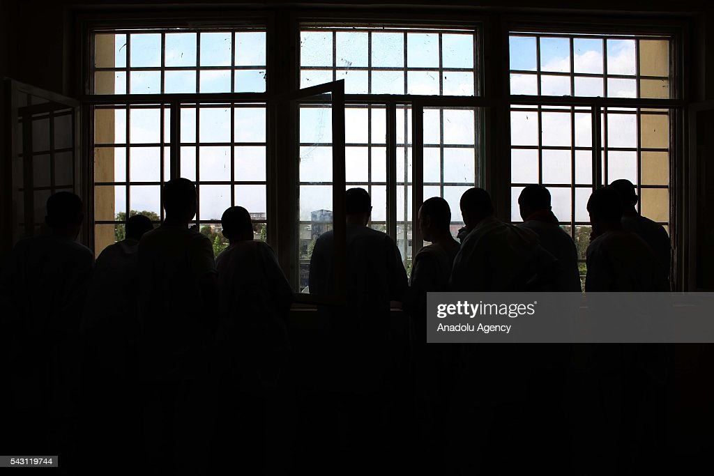 Afghan drug addicts seen as they look out in Jangalak hospital and shelter for drug addicts in Kabul, Afghanistan, on June 26, 2016. In December 1987 the UN general assembly decided to observe June 26 as the international day against drug abuse and illicit trafficking.