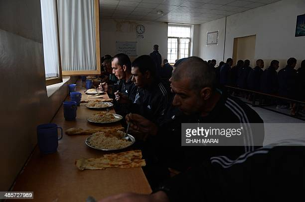 Afghan drug addicts undergoing rehabilitation have their lunch at the NEJAT drug treatment centre in Kabul on April 20 2014 The NEJAT Centre is an...