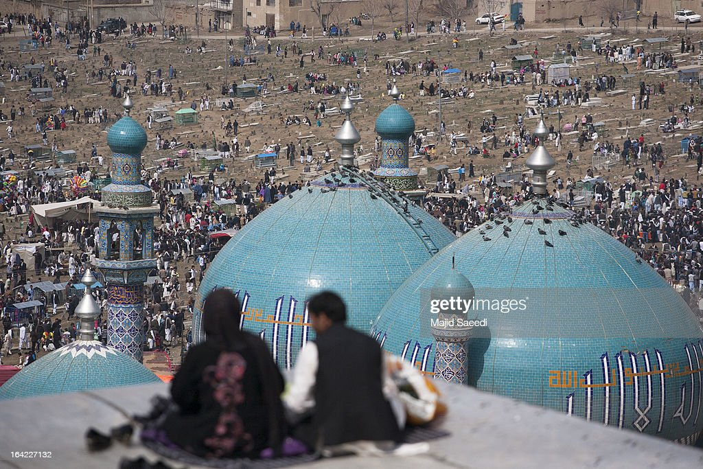Afghan families gather near the Sakhi shrine, which is the centre of the Afghanistan new year celebrations during the Nowruz festivities on March 21, 2013 in Kabul, Afghanistan. Nowruz is an ancient festival which marks the beginning of the spring equinox and the start of the year in the Iranian calendar, which this coming year will be 1392.