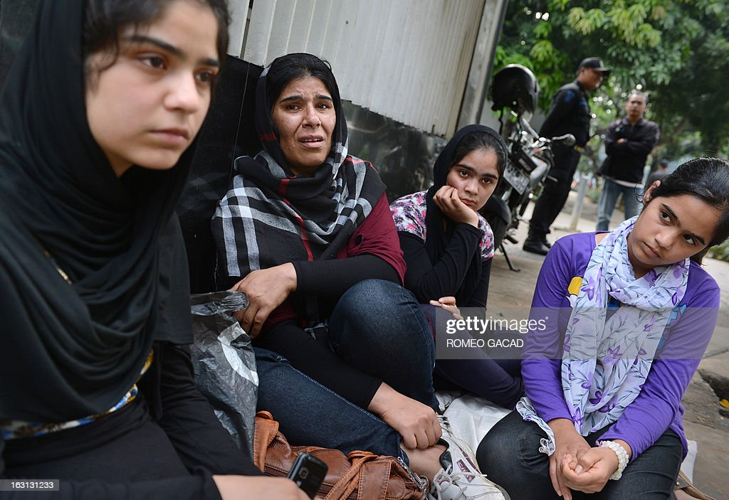 Afghan family members Sangita Bashardost (L), mother Nabila Bashardost (2L), and sisters Samera (3L) and Tirina (4L) sit outside United Nations High Commissioner for Refugees office in Jakarta on March 5, 2013, after the family's application for refugee status was denied. At a lost on what to do Sangita said her father is considering to take the family on illegal boat transport that will take them to Australia's Christmas island. Australia is facing a steady influx of asylum-seekers arriving by boat, many of whom use Indonesia as a transit hub, paying people-smugglers for passage on leaky wooden vessels after fleeing their home countries. More than 300 boatpeople have died en route to Australia last year.