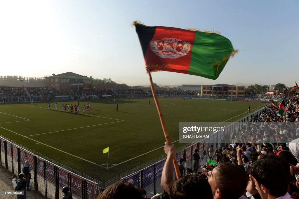 Afghan fans celebrate following their team's second goal against Pakistan at the Afghanistan Football Federation (AFF) stadium in Kabul on August 20, 2013. Afghanistan's football team sparked rowdy celebrations across the war-battered nation on August 20 after securing an convincing 3-0 win over arch-rivals Pakistan in the first international match in Kabul for ten years. AFP PHOTO/ SHAH Marai