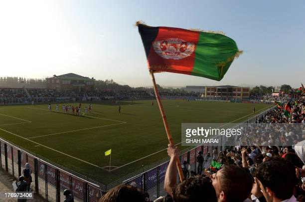 Afghan fans celebrate following their team's second goal against Pakistan at the Afghanistan Football Federation stadium in Kabul on August 20 2013...