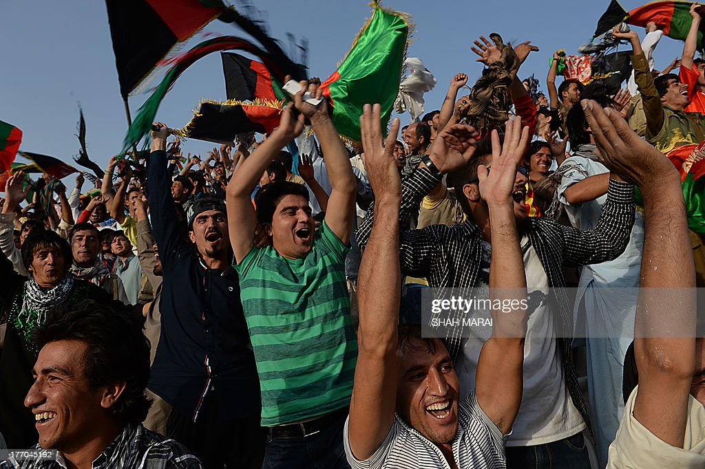 Afghan fans celebrate their team's 3-0 win against Pakistan at the Afghanistan Football Federation (AFF) stadium in Kabul on August 20, 2013. Afghanistan's football team sparked rowdy celebrations across the war-battered nation on August 20 after securing an convincing 3-0 win over arch-rivals Pakistan in the first international match in Kabul for ten years. AFP PHOTO/ SHAH Marai