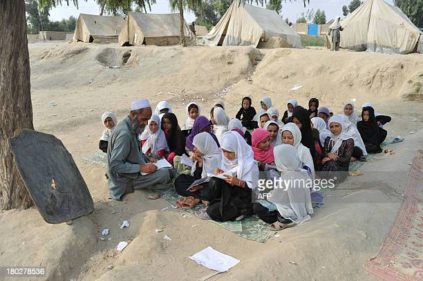 Afghan female children study at an outside classroom on the outskirts of Jalalabad on September 11 2013 Afghanistan has had only rare moments of...