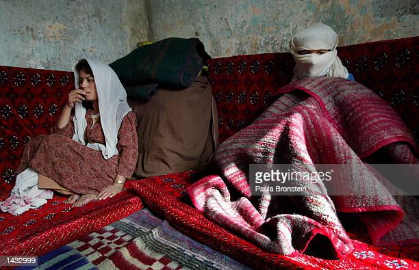 Afghan female inmates Engila and Qudsia sit in their cell at the female prison September 262002 in Kabul Afghanistan Englia's crime was getting...