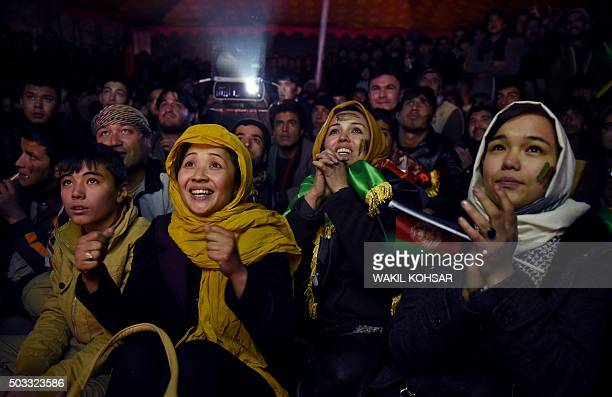 TOPSHOT Afghan football fans cheer for their national team as they watch a live broadcast of the SAFF Championship match between India and...