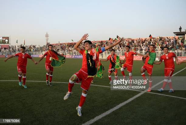 Afghan footballers celebrate their 30 win against Pakistan at the Afghanistan Football Federation stadium in Kabul on August 20 2013 Afghanistan's...