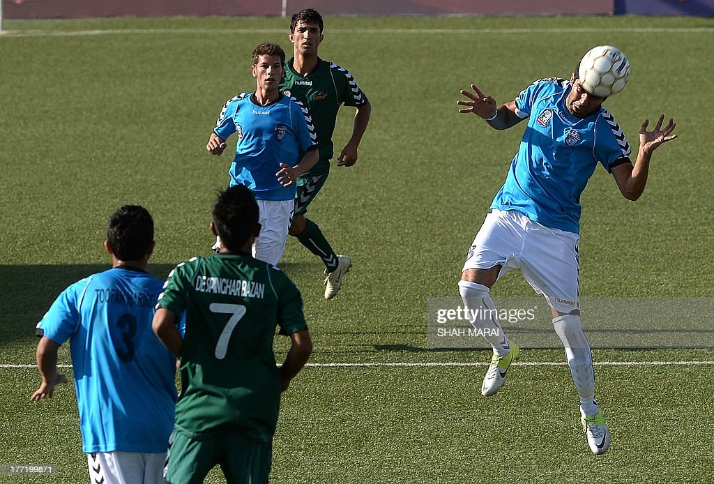 Afghan footballers from Tofaan Harirod (BLUE/R) and Spinghar Bazan fight for the ball during game of the Roshan Afghan premiere league at the Afghanistan Football Federation (AFF) stadium in Kabul on August 22, 2013. Afghanistan's second season of domestic league football opened on August 22, with eight sides competing in a tournament boosted by the national team's home win over arch-rival Pakistan this week. The league fixtures are a rare sporting highlight in a country beset for decades by war, poverty and Islamist extremism. Herat thrashed Jalalabad 5-0 in the opening game of the seven-week competition being played in the capital Kabul on a newly-renovated artificial pitch funded by world body FIFA. AFP PHOTO/ SHAH Marai