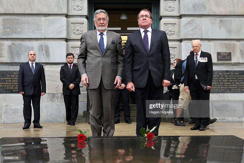 Afghan Foreign Minister Dr Zalmai Rassoul (L) and New Zealand Foreign Affairs Minister <a gi-track='captionPersonalityLinkClicked' href=/galleries/search?phrase=Murray+McCully&family=editorial&specificpeople=2182937 ng-click='$event.stopPropagation()'>Murray McCully</a> lay roses on the Tomb of the Unknown Warrior during a wreath-laying ceremony to acknowledge both Afghan and New Zealand losses in Afghanistan at the National War Memorial on March 19, 2013 in Wellington, New Zealand. Afghan Foreign Minister Dr Zalmai Rassoul is on the second day of a two day visit to New Zealand for bilateral talks.