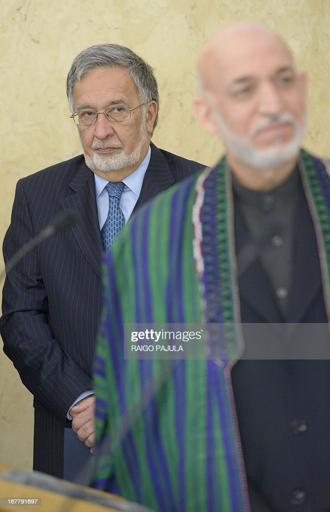 Afghan Foreign Minister Zalmai Rassoul (L) and Afghanistan's President Hamid Karzai (R) arrive for a meeting with their Estonian counterparts in Tallinn, Estonia on April 30, 2013. Karzai arrived on Monday, April 29, 2013 for a two day official visit to the Baltic state.