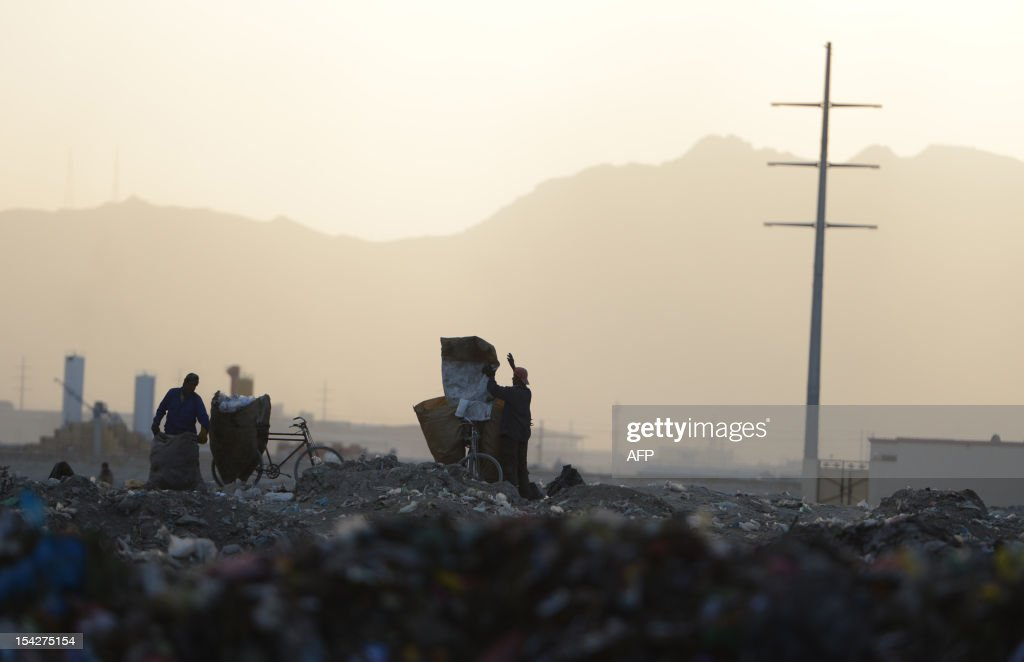 Afghan garbage collectors look for recyclable material from a landfill in the outskirts of Kabul on October 17, 2012. Over a third of Afghans are living in abject poverty, as those in power are more concerned about addressing their vested interests rather than the basic needs of the population, a UN report said.