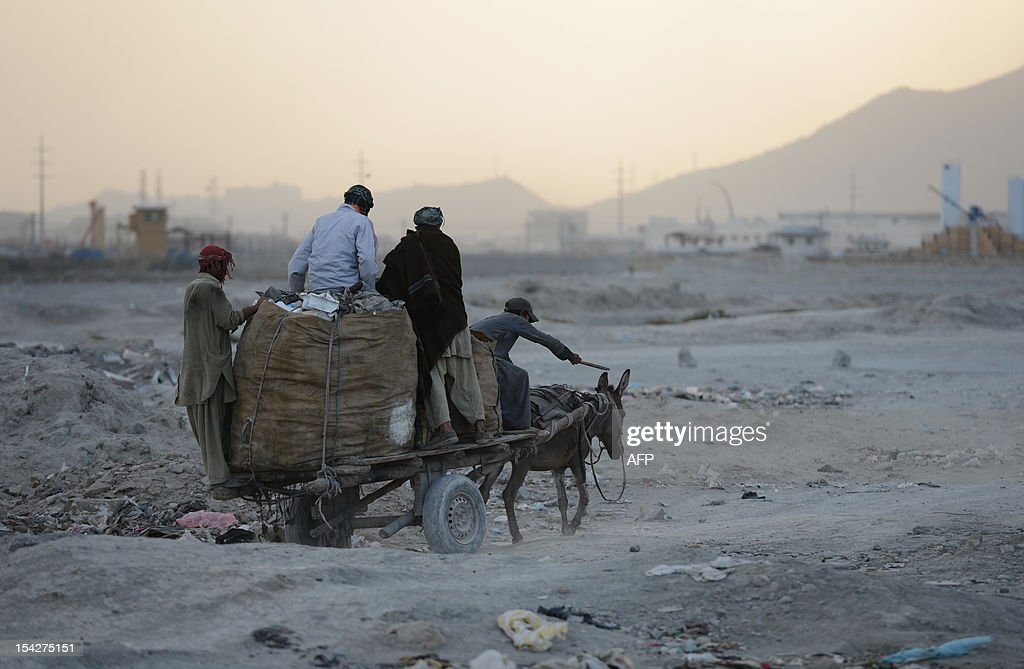 Afghan garbage collectors transport recyclable material on a donkey cart away from a landfill in the outskirts of Kabul on October 17, 2012. Over a third of Afghans are living in abject poverty, as those in power are more concerned about addressing their vested interests rather than the basic needs of the population, a UN report said.