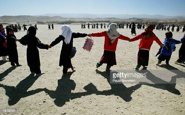 Afghan girls from the Chagcharan girls school play games after classes October 22 2002 in Chagcharan western Afghanistan Chagcharan the capitol of...