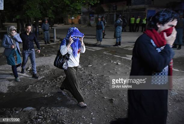 Afghan guests who were stuck inside a Kabul guesthouse walk after they were rescued by the security forces on May 13 2015 Gunmen stormed a Kabul...