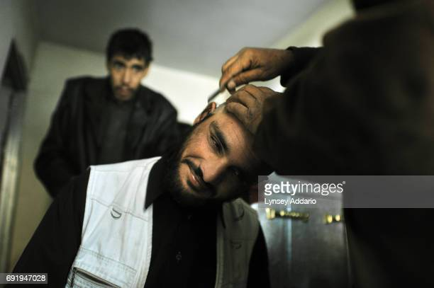 Afghan heroin addicts have their heads shaved on the first day of detoxification at the Nejad center in Kabul Afghanistan December 11 2008 According...