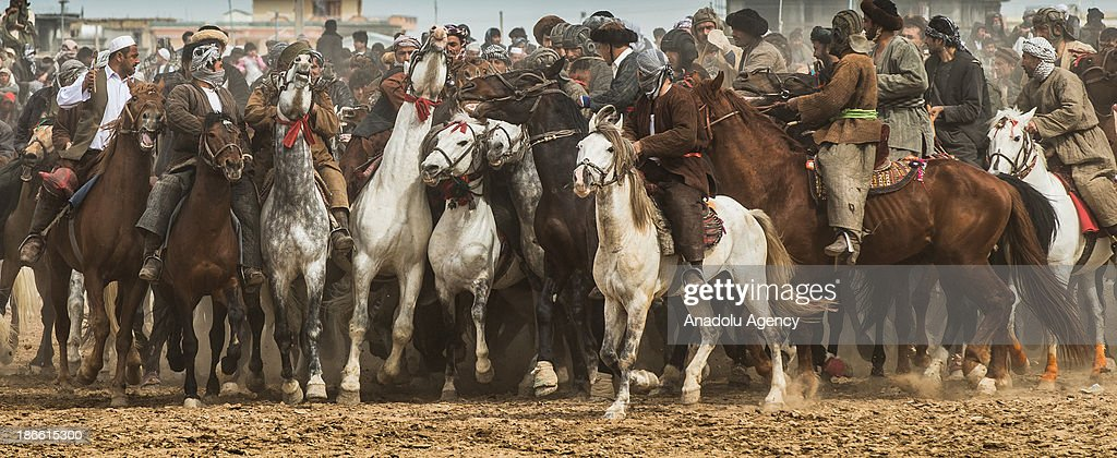 Afghan horsemen compete for a calf carcass during the Buzkashi game in Mazar-i Sharif, Afghanistan. The ancient game of Buzkashi is an Afghan national sport which is played by two teams of horsemen competing to throw an animal (calf, goat or sheep) carcass into a scoring circle. The object of the game is to get control of the carcass and bring it to the scoring area.