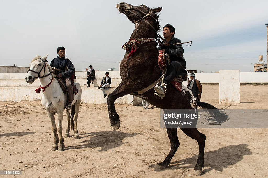 Afghan horsemen compete in the traditional game of Buzkashi in Mazar-i Sharif, Afghanistan. The ancient game of Buzkashi is an Afghan national sport which is played by two teams of horsemen competing to throw an animal (calf, goat or sheep) carcass into a scoring circle. The object of the game is to get control of the carcass and bring it to the scoring area.