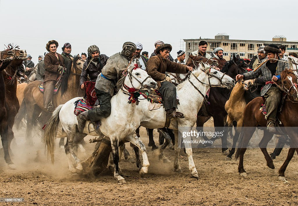 Afghan horsemen try to get a calf carcass during the Buzkashi game in Mazar-i Sharif, Afghanistan. The ancient game of Buzkashi is an Afghan national sport which is played by two teams of horsemen competing to throw an animal (calf, goat or sheep) carcass into a scoring circle. The object of the game is to get control of the carcass and bring it to the scoring area.