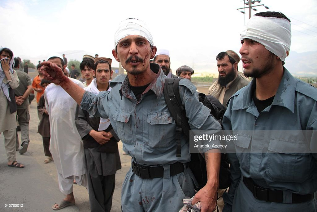 Afghan injured policemen are seen at explosion site in in Kabul, Afghanistan on June 30, 2016. The buses carrying police cadets were targeted as they were on their way from the neighboring Maidan Wardak province to Kabul. According to the preliminary reports, at least 30 policemen have lost their lives and dozens of others injuries.