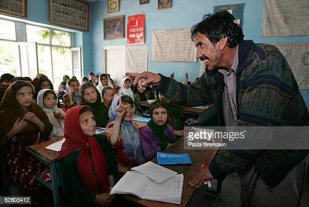 Afghan instructor Baridad gestures as he teaches Afghan girls during a Dari language class at the Aschiana school for street children May 12 2005 in...