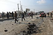 Afghan intelligence personnel arrive at the site of a suicide attack along the KabulJalalabad road in Kabul on November 27 2014 At least two Afghan...