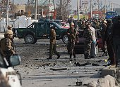 Afghan intelligence personnel inspect the site of a suicide attack along the KabulJalalabad road in Kabul on November 27 2014 At least two Afghan...